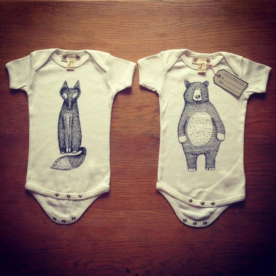 Hand screen printed organic baby onesies by RachelGaleDraws.