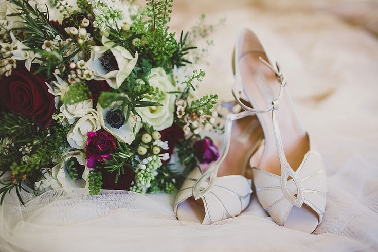 Rachel Simpson peep toe bridal shoes - Image by Lola Rose Photography - A Winter Wedding in a Tipi with Lace Fishtail Annasul Y Wedding Dress, Jenny Packham Headpiece & Rachel Simpson Shoes. Bridesmaids wear Red Dresses & Cream Fur Stole's and Groomsmen in Traditional Morning Suits.