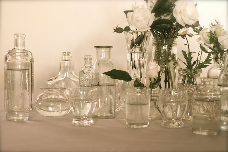 more glass vases and bottles