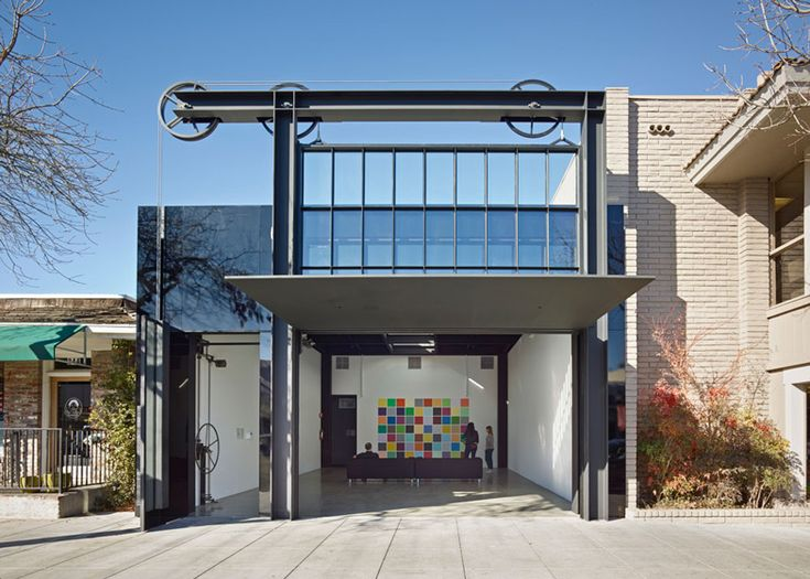 A wall of windows winches up and down to reveal the interior of this gallery renovation in Los Altos, California, by Seattle architect Tom Kundig.