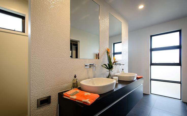 Twin vanities, what's not to love! The textured wall covering is another highlight of this ensuite bathroom