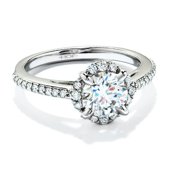 Brides.com: . The Sensation Engagement Ring style from Hearts on Fire features a diamond halo surrounding a diamond set atop a diamond encrusted band. This diamond solitaire engagement ring is available in platinum or 18K white gold, $4,250, Hearts on Fire. See more platinum engagement rings.