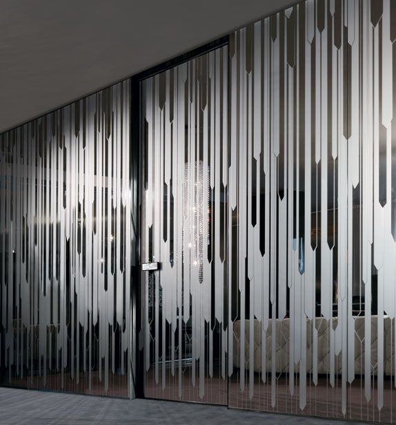 A wall converted in a perfect glassy wall screen. The white shades give it a balanced privacy
