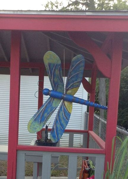 Dragonfly made of modified ceiling fan blades. Body turned on lathe. Hand painted.