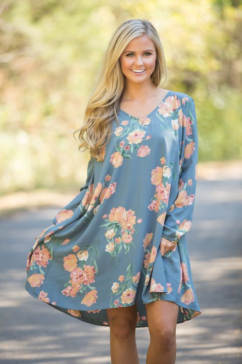 This sweet floral dress is the perfect way to transition spring and summer florals to a stylish fall look! We love the combination of ocean blue, yellow, coral, orange, jade, and white for a beautiful