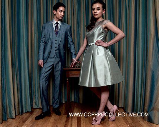 "www.corpocollective.com... HER -  50′style cocktail dress, THEIA; pumps, VALENTINO; ""2012 Entwined"" earrings & ring, LINKS OF LONDON HIM -suit, HUGO BOSS; tone-on-tone paisley shirt & tie, ETRO; shoe, PAUL SMITH MODELS: Victoria Kotas + Brandon Ng STYLIST: Asha Binti Kingombe (clothing courtesy Holt Renfrew) PHOTOGRAPHY: Zac Pantalone HAIR: Dana Stefanelli MAKE-UP: Andreé Beaudoin"