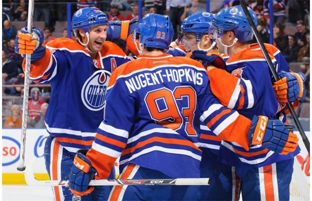 Ryan Smyth, left, of the Edmonton Oilers celebrates along with his teammates David Perron, second right, and Taylor Hall after scoring a goa...