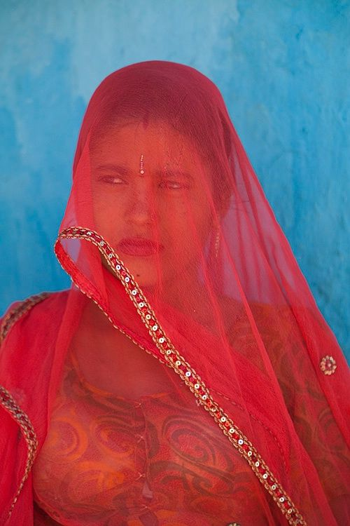 Young village girl, Rajasthan, India. She is Hindu but wears a thin veil from the influence of Muslims after the Moghul invasion...By Jim Zucherman
