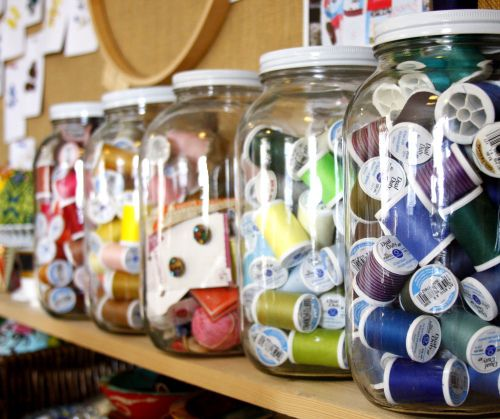 gallon-size clear jars for thread and such by designer Anna Maria Horner