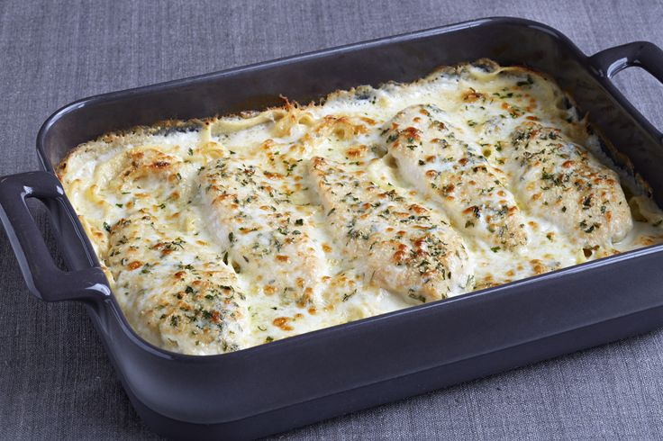 Creamy Alfredo sauce and grated Parmesan combine to make a terrific baked chicken and pasta dish that takes only 15 minutes to put together.