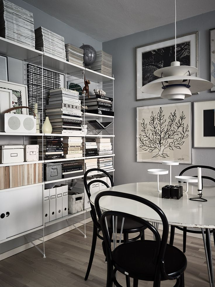 Grey living room with string shelves