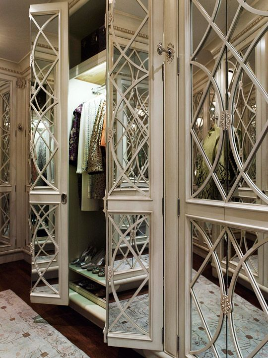 glamour dressing room with mirrors and custom cabinetry