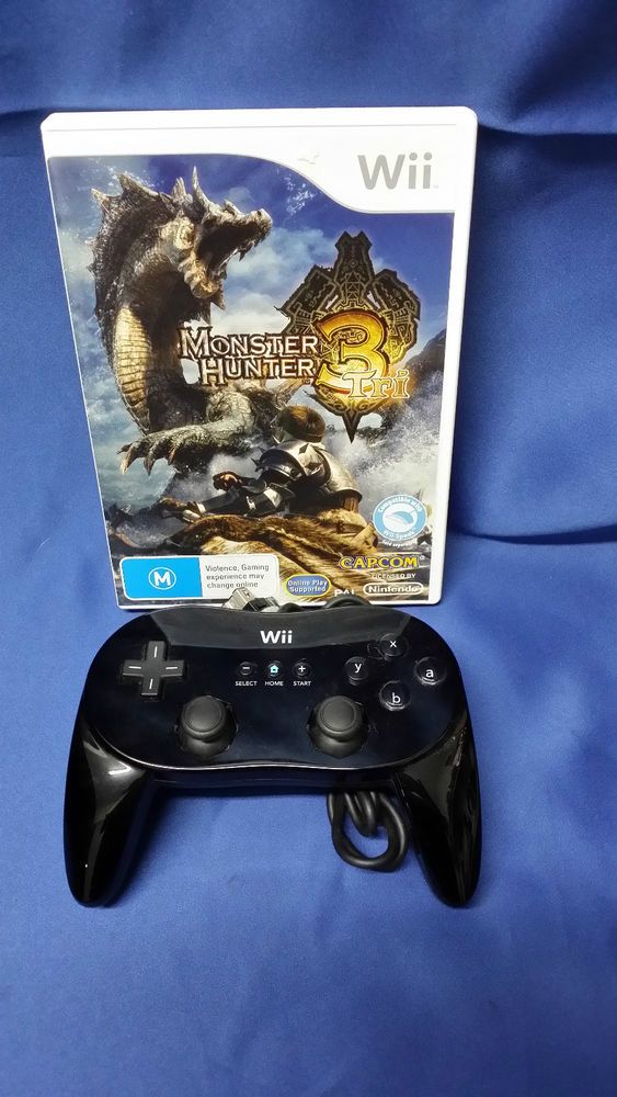 Wii  MONSTER HUNTER 3 TRI & HAND CONSOLE **CHARITY AUCTION**