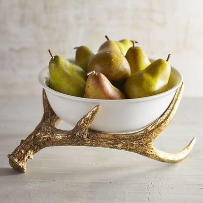 Give your tabletop a handsome homage to nature with our exclusive ceramic serveware. Crafted with golden antlers, each piece gives your celebrations a dash of rustic-meets-glam.