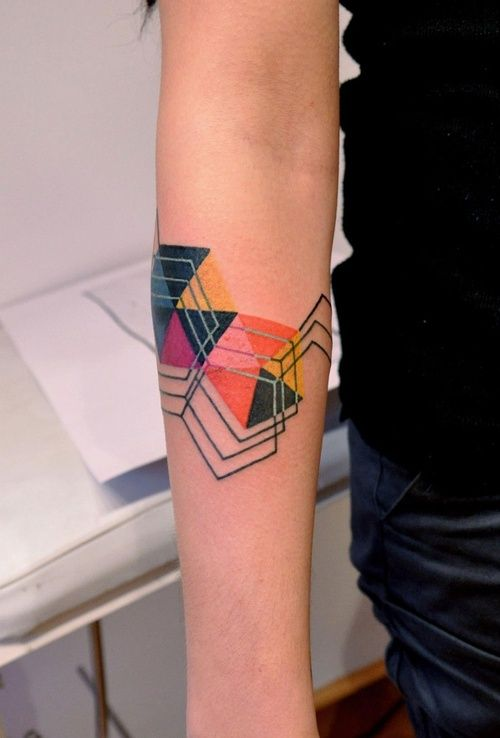 This is the tattoo that made me decide to give geometric tattoos their own board... Any thoughts on how a comparable design (overlapping full and empty shapes of different colors) could be applied to the shoulder area?