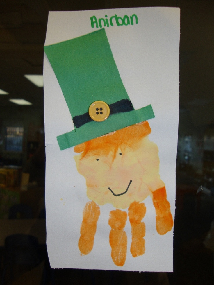 Hand print Idea for St. Patty's! Make peach paint by combining with white paint, some yellow touch, and a touch of red! Also, yellow buttons, drew the black brim with marker.