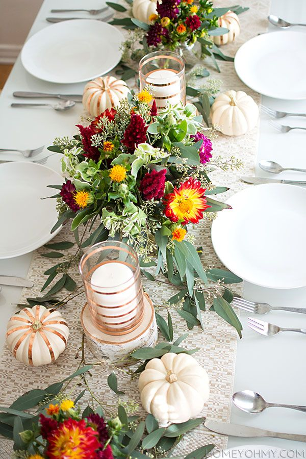 Pretty fall tablescape with gold accents and fresh flowers.