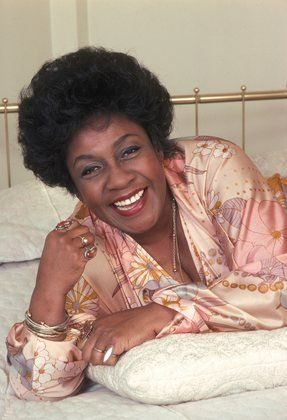 """Isabel Sanford  (August 29, 1917 – July 9, 2004) was an American stage, film and television actress best known for her role as Louise """"Weezy"""" Jefferson on the CBS sitcoms All in the Family (1971–1975) and The Jeffersons (1975–1985). She was the first African American actress to win a Primetime Emmy Award for Outstanding Lead Actress in a Comedy Series."""