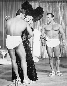 Mae West and men in sandals