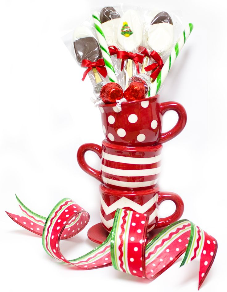 """Unique Ceramic Tea Cup Vase with tasty chocolate covered spoons artfully arranged into an unusual Christmas gift sure to please everyone.  Includes 6 Chocolate Dipped Gold Plastic Spoons, 4 Chocolate Bark Bells and 2 Wintergreen flavored Old Fashioned Candy Sticks.  Ceramic Teacup Vase measures 7"""" tall."""