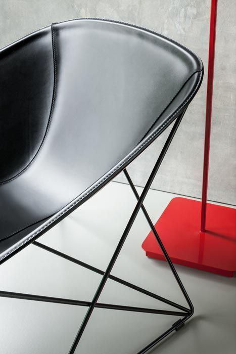 LEMA   Signed by Ferruccio Laviani, POPSI lounge chair stands out for the sought-for design and choice of refined materials: metal and leather. Its base consists of rod weave, a light metal web with a complex pattern.