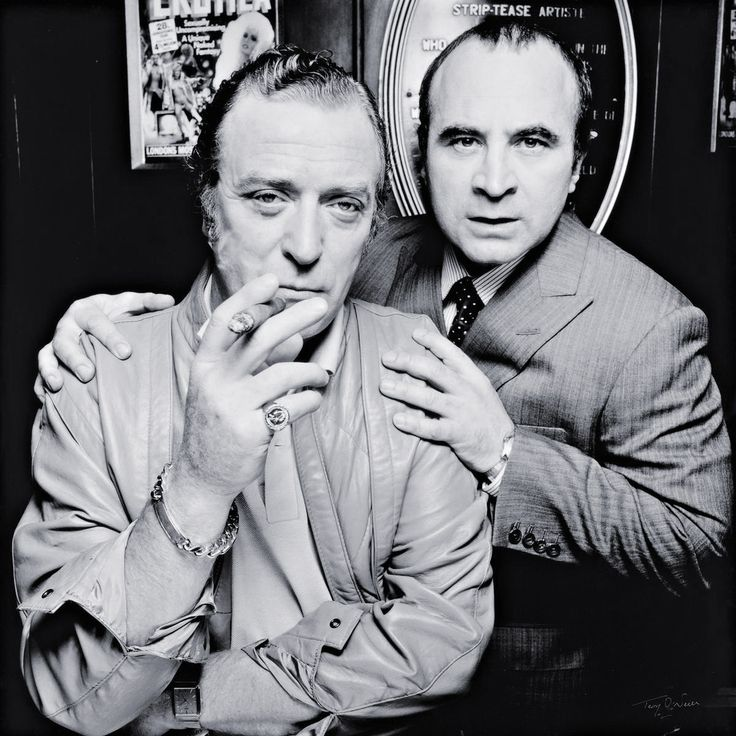 Michael Caine & Bob Hoskins, Raymond's Revue Bar, London    photo by Terry O'Neill, 1985