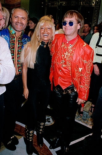 Gianni and Dontella Versace with Elton John at the opening of the new Versace store in London, May 28, 1992.