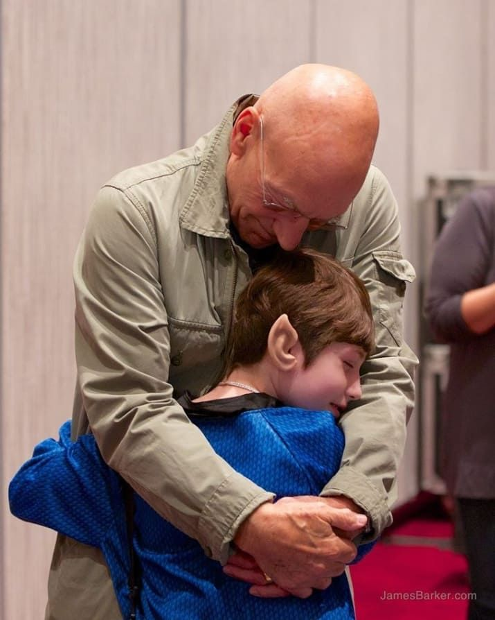 Dragoncon 2014 photo. The Make-a-Wish foundation made it possible for 10 year old Dawn, who has a life threatening illness, to meet Patrick Stewart backstage. He was about to speak to a packed room of 2000 people, but they sat down and he really focused on her; they talked for about 15 minutes. As things are winding down and she and her family are getting ready to go, Dawn unexpectedly throws him this huge hug, and you can see the happiness in both their faces. Bravo Sir Patr