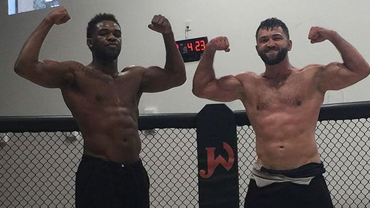Jon Jones is continuing his weight lifting regimen, and already looks massive next to an actual heavyweight.