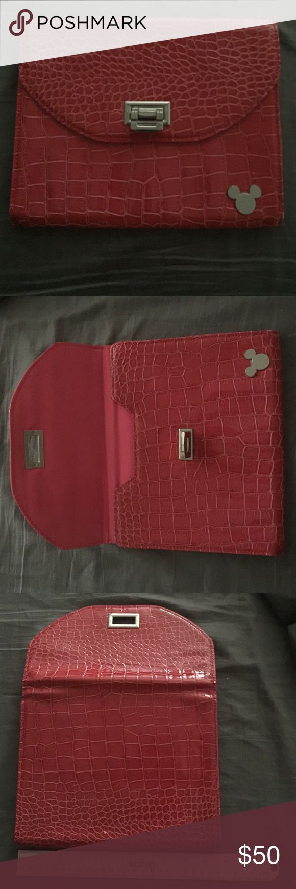 Disney - Large IPad cover with Mickey Mouse Emblem DISNEY IPad cover. Pink in color with Mickey Mouse Emblem. Like new. No dust bag. 9 3/4 inches long 8 inches high. Pink with silver hardware. Like new!!! Disney Accessories Tablet Cases