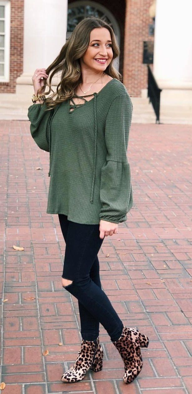 191dc2cb #winter #outfits green long-sleeve lace-up peasant blouse, distressed green skinny  jeans and beige-and-black leopard almond-toe booties outfit
