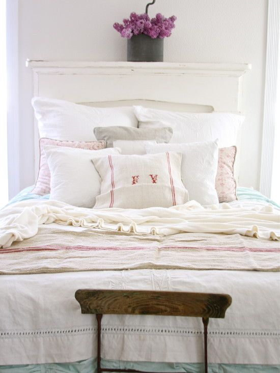 antique / vintage French linen bedding with monogrammed pillow.  clean and romantic guest bedroom