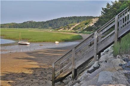 This Wellfleet Cape Cod vacation rental located on a spectacular bluff overlooking the Cove and Cape Cod Bay. Check out the views!