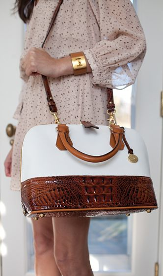 The shape of this Brahmin Vivan Satchel, resembles the look the Classic Louis Vuitton Alma Satchel. Not only does Brahmin offer this bag in other exciting colors, you will also appreciate the inexpensive price!