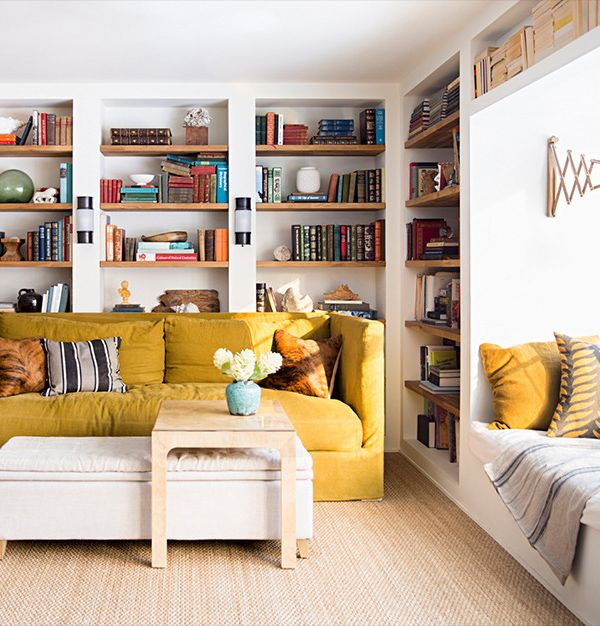 Yellow couch, bookshelves, built ins, open shelving, living room, coffee table
