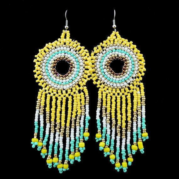Bold and bright extra large disk earrings created   4 colors to choose from in colors mix , turquoise,white,yellow,black   and metallic silver gold seed beads. sewn beads are woven to   make these beautiful earrings hook silver. These large, bold, statement earrings measure length including hook 4.72 (12cm) + 1.37 (3.5cm) disk head diameter gorgeous for daywear and stunning for the night out.   >>>>> Payment <<<<< We accept PayPal >> << You can proces...