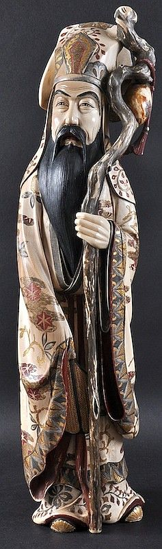A LARGE EARLY 20TH CENTURY JAPANESE MEIJI PERIOD IVORY OKIMONO modelled as an immortal holding aloft a staff. Signed. 1ft 10ins high.