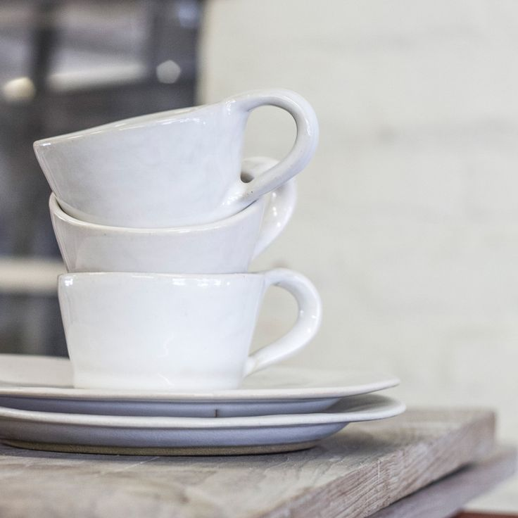 Classic White Mug and Saucer combination. Hand crafted ceramics made in Cape Town, South Africa. Contact us or for more information visit www.mervyngers.com