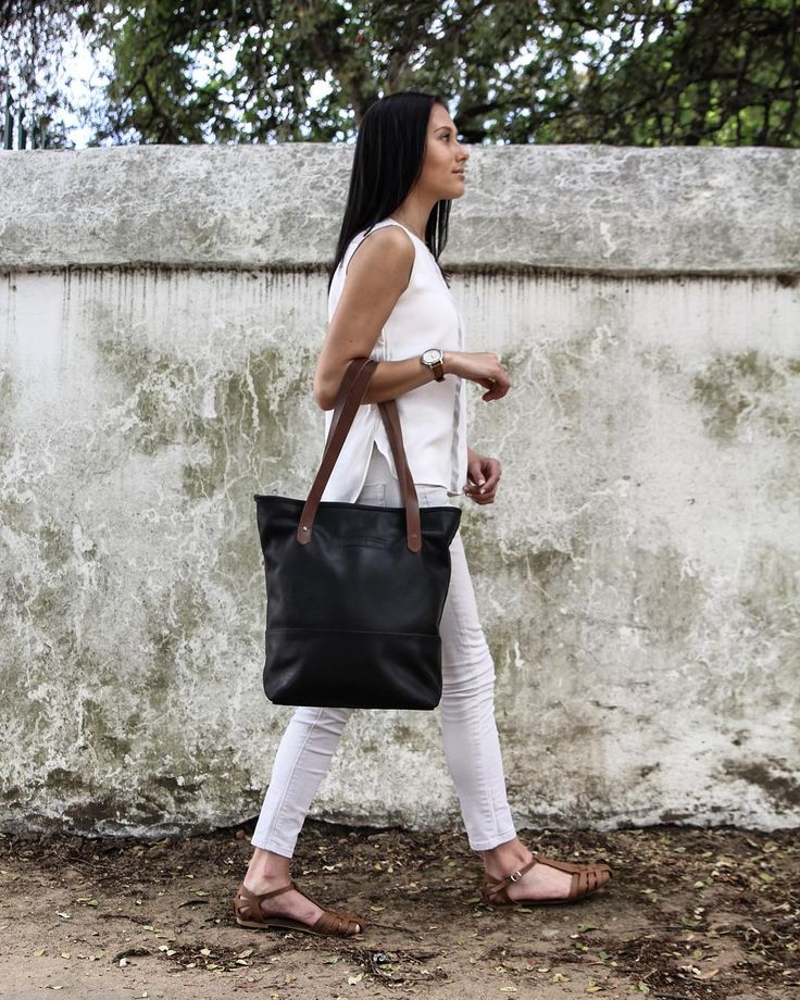 Sophisticated beauty. Introducing the newest member to our FOM family, The Jane Black. Now available online at www.freedomofmovement.co.za and in our FOM original stores.  #theJane #fashion #trends #style #handmade #handbags #ladiesfashion #leatherhandbags #tote #leather #craft #proudlysouthafrican #fombrand  Photo credits: @thatcapetownkid