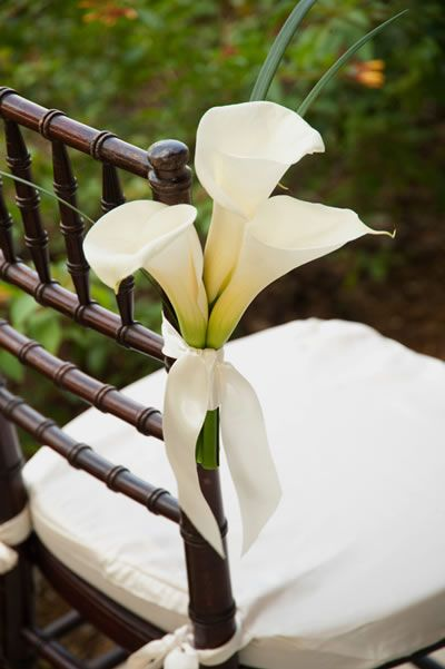 wedding flowers, wedding decor, aisle decor, wedding aisle, wedding calla lilies photo source theoriginalflowercompany.com shop wedding flowers and wedding decorations www.afloral.com