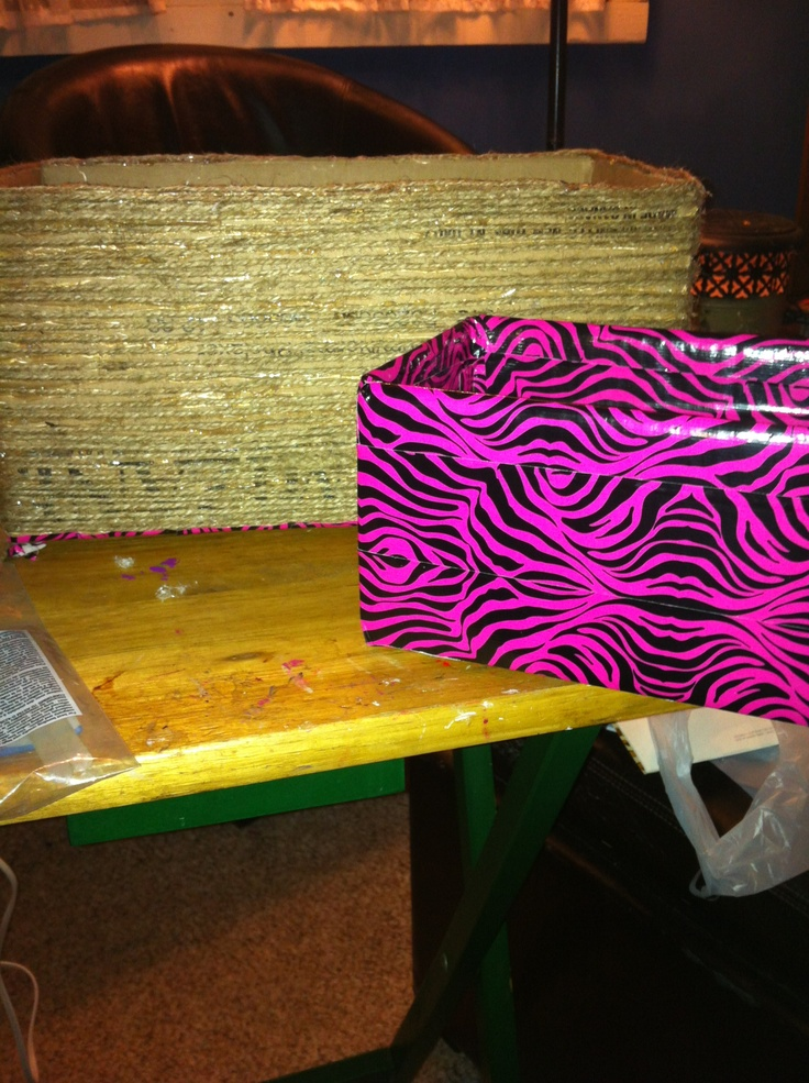 Dyi storage boxes cheap use a old cardboard box and use jute or duct tape to decorate !