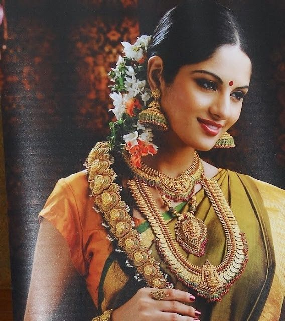 South Indian bride with temple jewelry, heavy jhumkas and hair