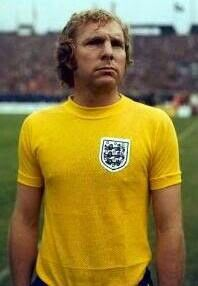 The great Bobby Moore in the horrendous yellow 70's England shirt