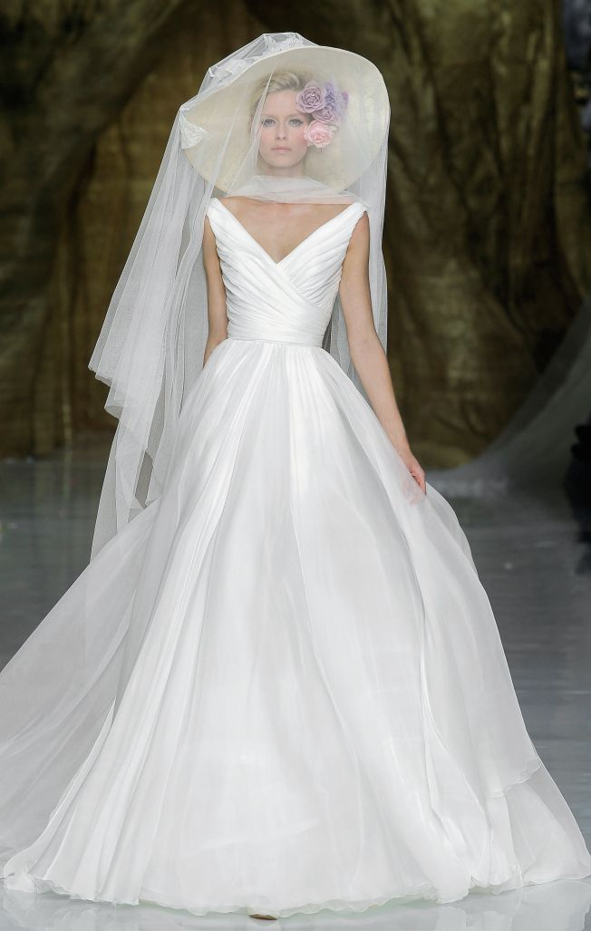 "7 Pronovias Wedding Dresses We Love #TheKnot  Love the dress but not the ""bee keeper"" hat!"