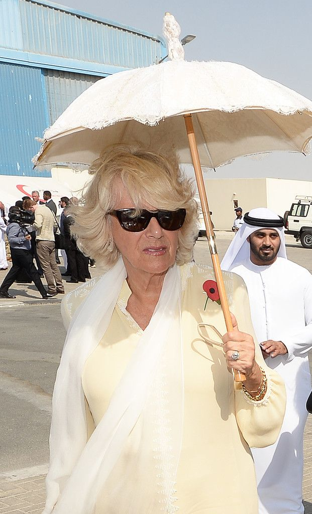 Camilla Parker Bowles Photos Photos - Camilla, Duchess of Cornwall holds a parasol as she tours the International Humanitarian City to see the innovation and best practice in humanitarian aid delivery on November 8, 2016 in Dubai, United Arab Emirates. Prince Charles, Prince of Wales and Camilla, Duchess of Cornwall are on a Royal tour of the Middle East starting with Oman, then the UAE and finally Bahrain. - The Prince of Wales and The Duchess of Cornwall Tour Abu Dhabi - Day 3