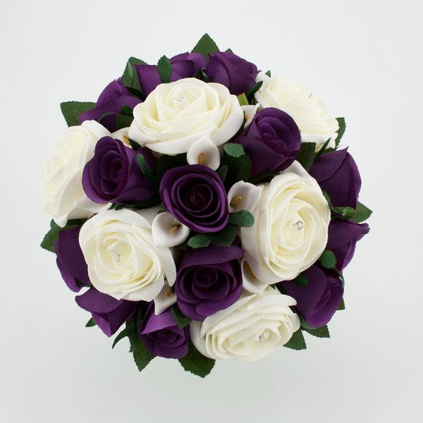 "Let the ""drama"" in your wedding be the contrast of the white against the dark purple. Wedding Bouquet Purple Silver Wedding Flowers found on Polyvore"