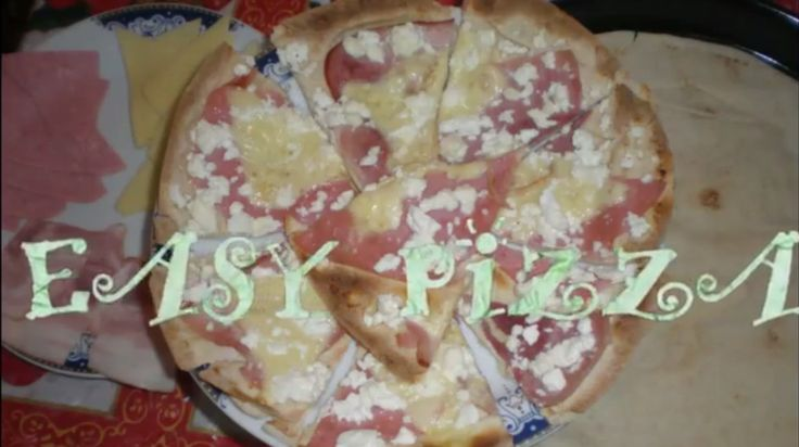 How to: Make an easy pizza  #SUBSCRIBE to our YouTube channel: https://www.youtube.com/channel/UC23VnLLT--eORh8oFGPEiJg Find us on #Facebook: https://m.facebook.com/everythingshewantsandneeds #Follow us on Instagram: http://instagram.com/whatagirlwantsandneedsbeauty More things on our #Βlog: http://whatagirlwantsandneedsbeauty.blogspot.gr/ Or #Email us : whatagirlwantsandneedsbeauty@gmail.com