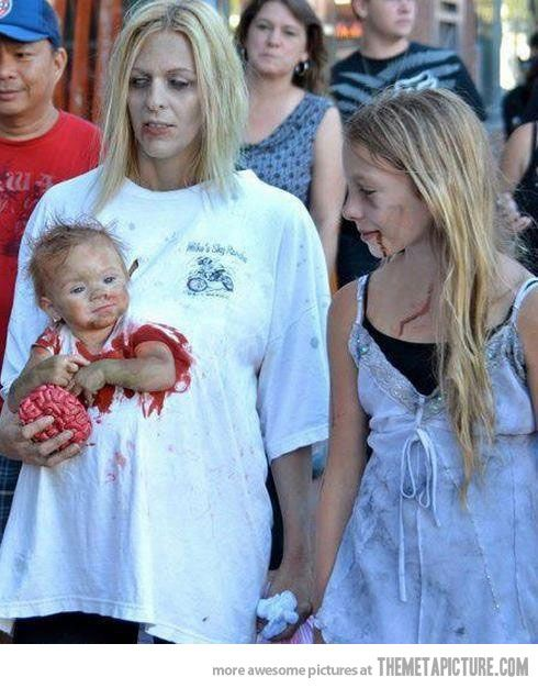 Coolest mommy baby holloween costume EVER! Carla, my daughter, was at   Comic-Con last year and saw them there! A whole family of Zombies!!!
