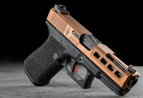 Custom Glock 19 Gen 4 done by Zev Tech with a Dragonfly slide with burnt bronze Cerakote and a Zev Tech Fulcrum trigger. All it needs is some Trijicon HD night sights.