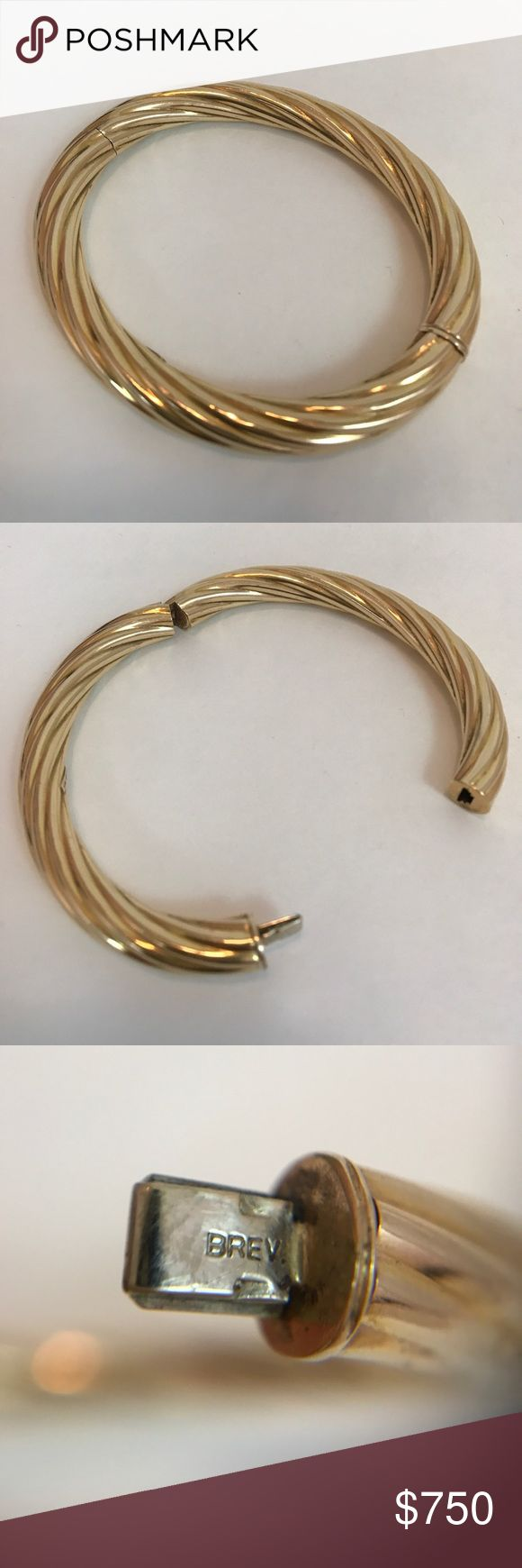 "Beautiful Hinged 585 Gold Bangle Bracelet  (14K) Beautiful hinged 585 gold bangle bracelet. 585 is equivalent to 14K gold. This bracelet has a hidden clasp release. Fluted, rope like detailing. The bracelet has a few very hard to notice dents, shown in photos, not noticeable unless very close. Marked BREV in the clasp and marked 585, along with some other markings I can't read, on the inside. Bracelet is hollow. Weight is 16.59G and 3"" across. (6.75"" diameter). This price is firm and I do…"